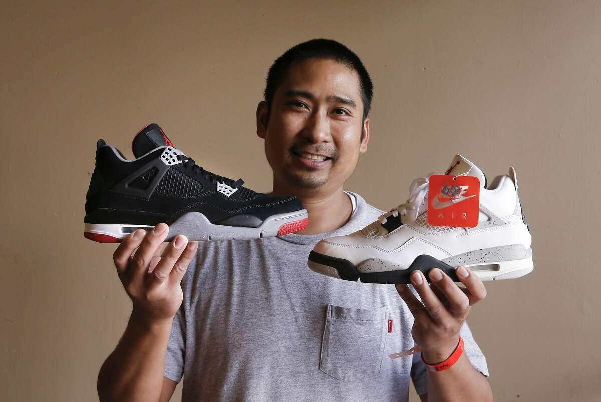 Longtime collector Chris Datoc of Alamo displays his Air Jordans during during KicksFest San Francisco at the San Mateo Expo enter.