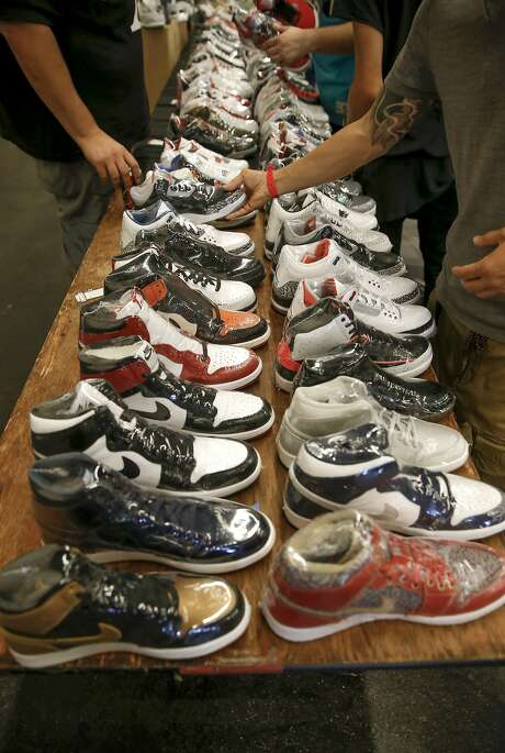 Shoe retailer the Fix of Alameda shrink-wraps its shoes at KicksFest San Francisco, a meetup of collectors selling or trading athletic footwear at the San Mateo County Expo Center on Aug. 29. Photo: Michael Macor, The Chronicle