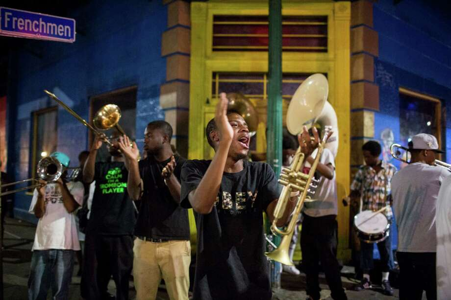 "Justin Terrell plays music with the Young Fellaz Brass Band on a street corner along Frenchmen Street in New Orleans, LA on August 26, 2015.  He said that the group met after Katrina to play all over the city.  ""We play for the love of the music,"" he said. Photo: Carolyn Van Houten, Staff / San Antonio Express-News / 2015 San Antonio Express-News"