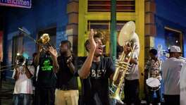 """Justin Terrell plays music with the Young Fellaz Brass Band on a street corner along Frenchmen Street in New Orleans, LA on August 26, 2015.  He said that the group met after Katrina to play all over the city.  """"We play for the love of the music,"""" he said."""