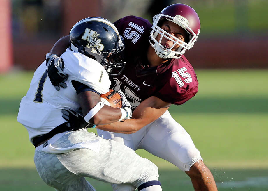 Trinity's Jai Boatman tackles Howard Payne's Tracy Morrison during first half action Saturday Sept. 6, 2014 at Trinity Football Stadium. Photo: Edward A. Ornelas /San Antonio Express-News / © 2014 San Antonio Express-News
