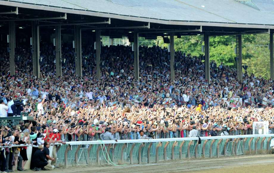 Spectators watch the Travers Stakes with American Pharoah at Saratoga Race Course Saturday afternoon, Aug. 29, 2015, in Saratoga Springs, N.Y. Keen Ice with Javier Castellano was the winner. (Will Waldron/Times Union) Photo: WW / 00033155B