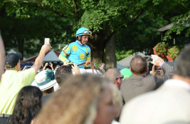 Victor Espinoza rides American Pharoah out of the paddock before the start of the Travers Stakes at Saratoga Race Course Saturday afternoon, Aug. 29, 2015, in Saratoga Springs, N.Y. Keen Ice with Javier Castellano was the winner. (Will Waldron/Times Union) Photo: WW / 00033155B