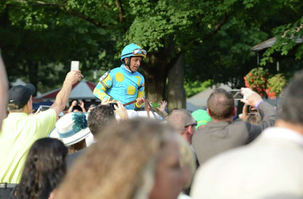 A capped-off crowd of 50,000 came to Saratoga Race Course to see American Pharoah compete in the Travers in 2015.