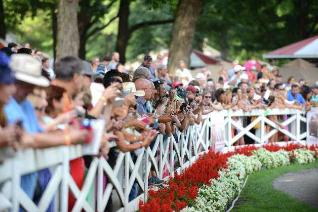 Spectators gather at the paddock rail to view American Pharoah before the start of the Travers Stakes at Saratoga Race Course Saturday afternoon, Aug. 29, 2015, in Saratoga Springs, N.Y. Keen Ice with Javier Castellano was the winner. (Will Waldron/Times Union) Photo: WW / 00033155B