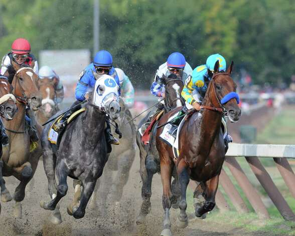 American Pharoah and Victor Espinoza, right, takes an early lead into the Clubhouse turn during the Travers Stakes at Saratoga Race Course Saturday afternoon, Aug. 29, 2015, in Saratoga Springs, N.Y. Keen Ice with Javier Castellano was the winner. (Will Waldron/Times Union) Photo: WW / 00033155B