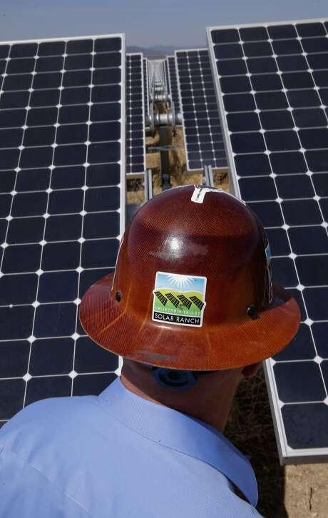 SunPower's west coast operations leader Lance Long walks past a row of solar panels at the California Valley Solar Ranch near Santa Margarita in San Luis Obispo County. Photo: Michael Macor, The Chronicle