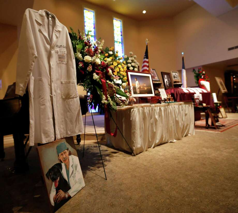 "People file past the casket and photos of H. ""Red"" Duke, Jr., M.D., renowned surgeon and medical educator, as the public was invited to pay their respects for Duke Saturday afternoon at the Jasek Chapel of Geo. H. Lewis & Sons, 1010 Bering Drive on Saturday, Aug. 29, 2015, in Houston. The public is also invited again from 9am until eight o'clock in the evening on Sunday, the 30th of August. The family will gather for a private graveside service at the Texas State Cemetery in Austin. Photo: Karen Warren, Houston Chronicle / © 2015 Houston Chronicle"