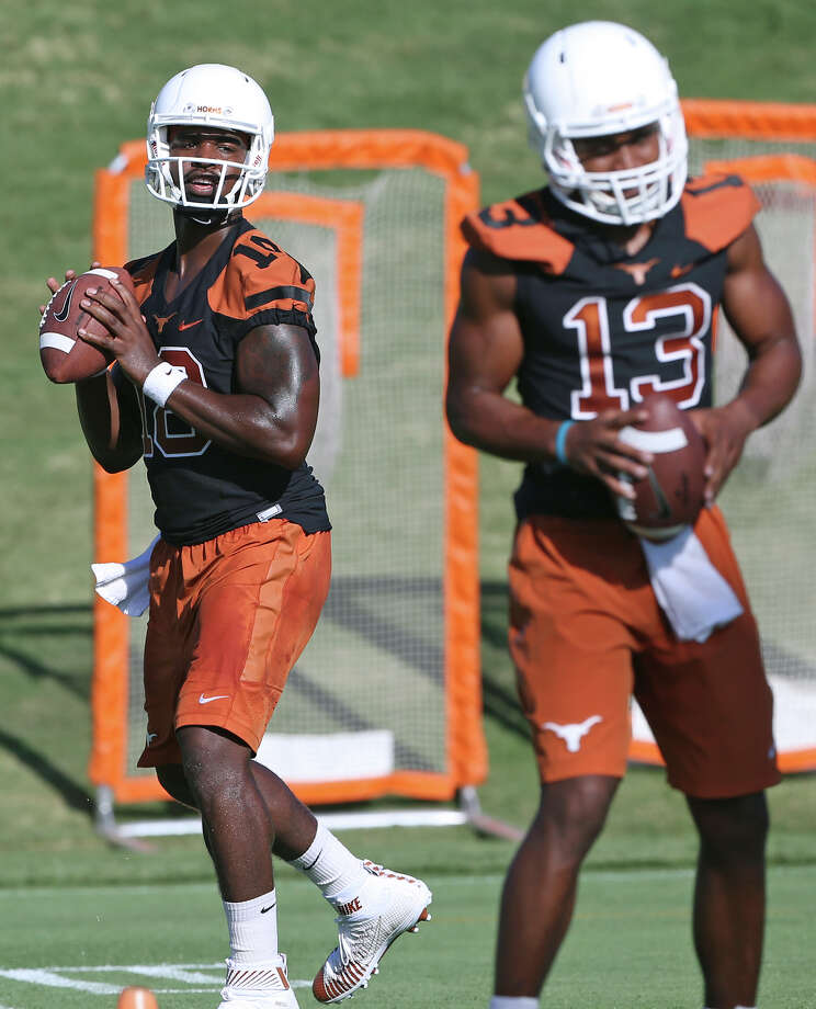 Tyrone Swoopes (18) throws as Jerrod Heard redoes as the Longhorns hold their first football practice on August 7, 2015. Photo: Tom Reel, Staff / San Antonio Express-News