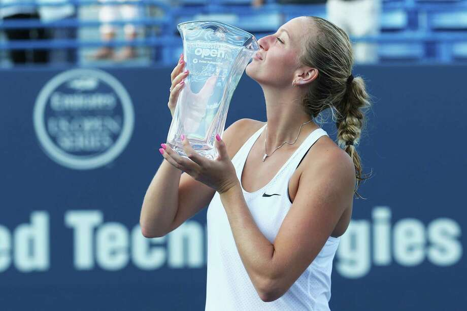 NEW HAVEN, CT - AUGUST 29:  Petra Kvitova of Czech Republic stands with her trophy after defeating Lucie Safarova of Czech Republic in the final round on Day 6 of the Connecticut Open at Connecticut Tennis Center at Yale on August 29, 2015 in New Haven, Connecticut. Photo: Maddie Meyer, Getty Images / 2015 Getty Images