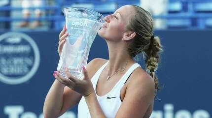 NEW HAVEN, CT - AUGUST 29:  Petra Kvitova of Czech Republic stands with her trophy after defeating Lucie Safarova of Czech Republic in the final round on Day 6 of the Connecticut Open at Connecticut Tennis Center at Yale on August 29, 2015 in New Haven, Connecticut.