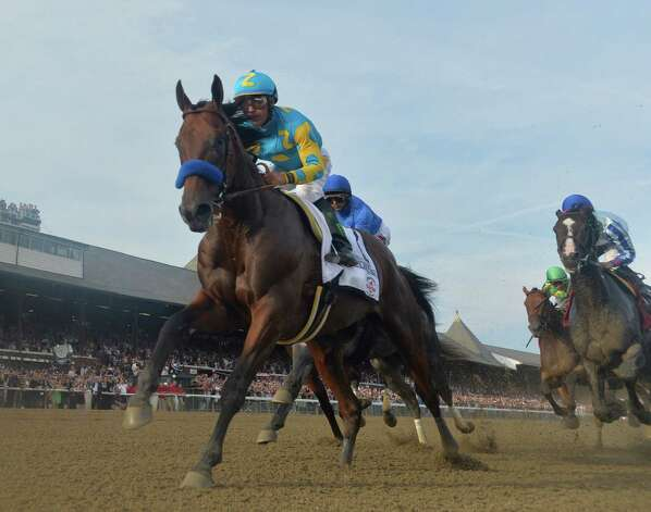 American Pharoah with jockey Victor Espinoza leads the field in to the first turn during the146th running of the Travers Stakes Saturday evening Aug. 29, 2015 at the Saratoga Race Course in Saratoga Springs, N.Y.    (Skip Dickstein/Times Union) Photo: SKIP DICKSTEIN / 00033110A