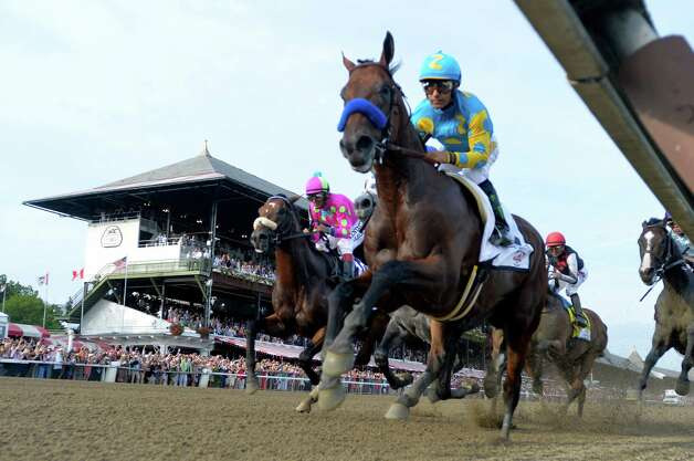 American Pharoah with jockey Victor Espinoza leads the field in to the first turn of 146th running of the Travers Stakes Saturday evening Aug. 29, 2015 at the Saratoga Race Course in Saratoga Springs, N.Y.    (Skip Dickstein/Times Union) Photo: SKIP DICKSTEIN / 00033110A