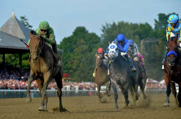 Keen Ice with jockey Javier Castellano, left overtakes American Pharoah with jockey Victor Espinoza to win the 146th running of the Travers Stakes Saturday evening Aug. 29, 2015 at the Saratoga Race Course in Saratoga Springs, N.Y.    (Skip Dickstein/Times Union) Photo: SKIP DICKSTEIN / 00033110A