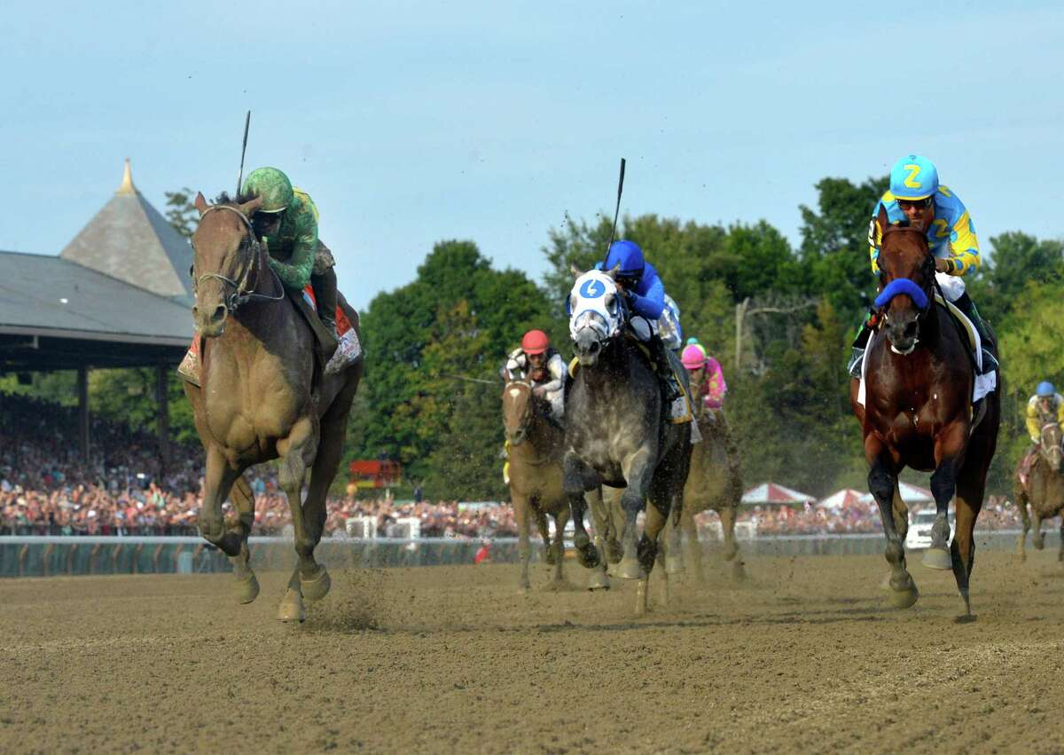 Keen Ice with jockey Javier Castellano, left, overtakes American Pharoah with jockey Victor Espinoza to win the 146th running of the Travers Stakes Saturday evening, Aug. 29, 2015, at the Saratoga Race Course in Saratoga Springs, N.Y. (Skip Dickstein/Times Union)
