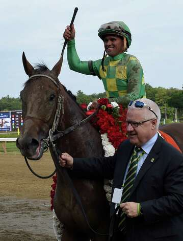 Donegal Racing's Jerry Crawford leads Keen Ice with jockey Javier Castellano, in to the winner's circle after winning the 146th running of the Travers Stakes Saturday evening Aug. 29, 2015 at the Saratoga Race Course in Saratoga Springs, N.Y.    (Skip Dickstein/Times Union) Photo: SKIP DICKSTEIN / 00033110A
