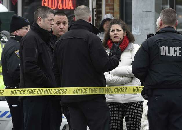 Albany County Assistant District Attorney Mary Tanner-Richter, in white, is given details on the crash that killed Ashiqur Rahman at the intersection of Quail Street and Central Avenue Thursday morning Feb. 12, 2015 in Albany, N.Y. (Skip Dickstein/Times Union) ORG XMIT: MER2015021213315935 Photo: SKIP DICKSTEIN