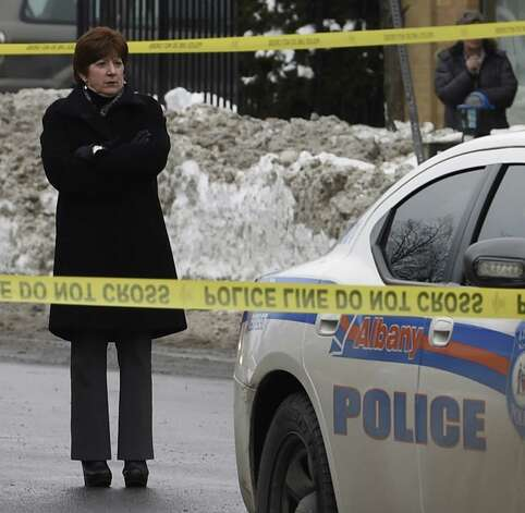 Albany Mayor Kathy Sheehan stands at the scene of the crash that killed Ashiqur Rahman at the intersection of Quail Street and Central Avenue Feb. 12, 2015 in Albany, N.Y. (Skip Dickstein/Times Union) ORG XMIT: MER2015021213315434 Photo: SKIP DICKSTEIN