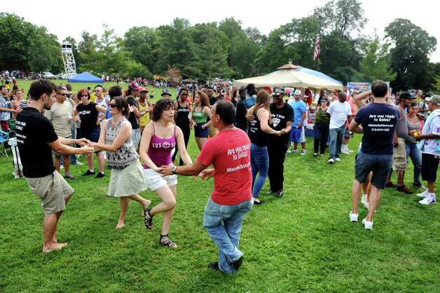 Dancers show off their salsa moves to the music of Alex Torres and His Latin Orchestra during the Albany LatinFest on Saturday, Aug. 29, 2015, at Washington Park in Albany, N.Y. LatinFest celebrates the Hispanic cultural heritage and the contributions made by Hispanic Americans. (Cindy Schultz / Times Union) Photo: Cindy Schultz / 00033166A