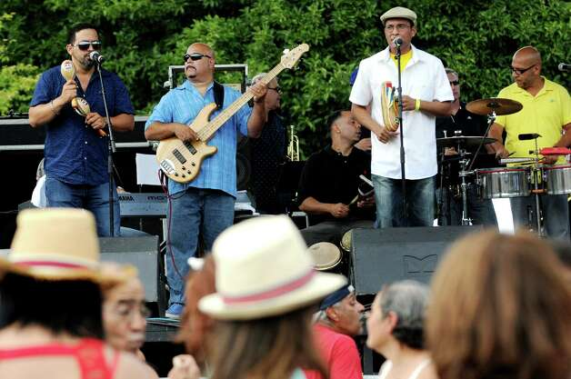 Alex Torres, second from left, and his Latin Orchestra perform during the Albany LatinFest on Saturday, Aug. 29, 2015, at Washington Park in Albany, N.Y. LatinFest celebrates the Hispanic cultural heritage and the contributions made by Hispanic Americans. (Cindy Schultz / Times Union) Photo: Cindy Schultz / 00033166A
