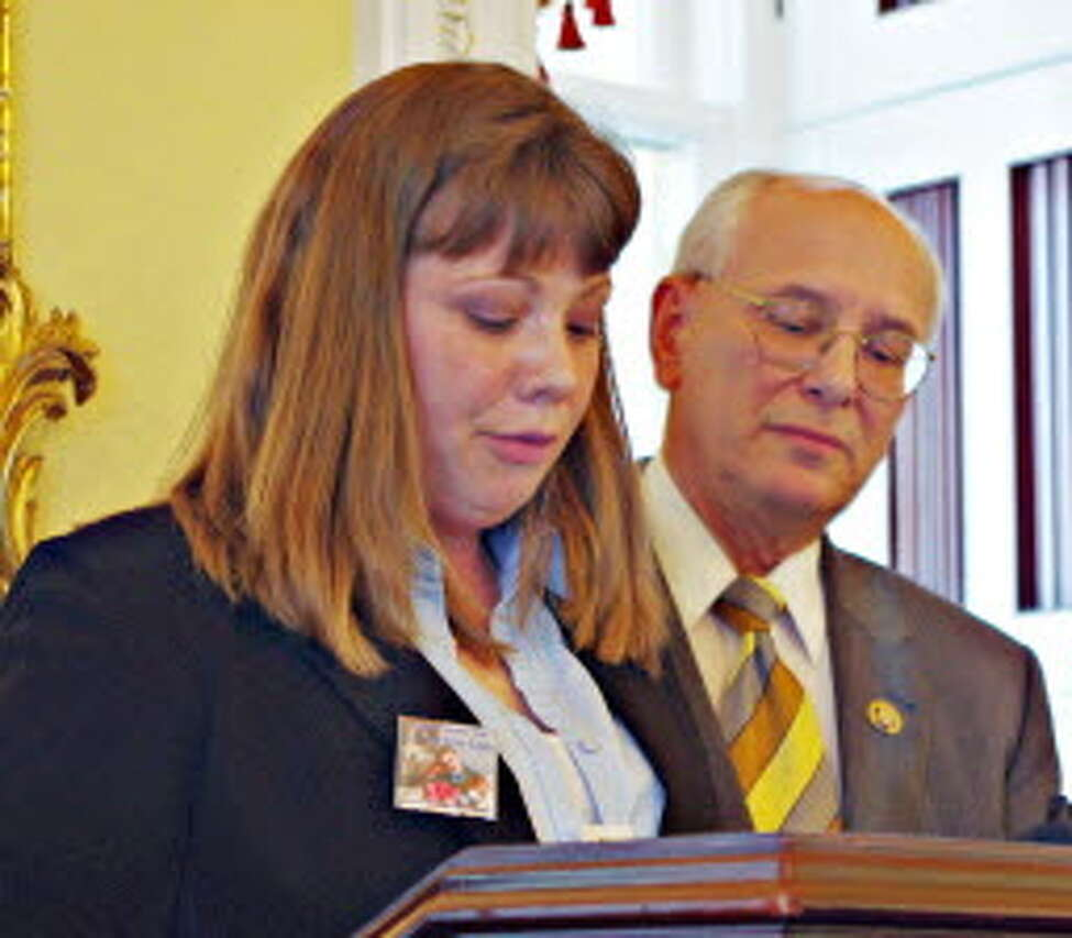 Rep. Paul Tonko, D-Amsterdam, looks on as Hope Rivenburg recounts the death of her husband, a long-haul trucker who was murdered while parked at an abandoned South Carolina gas station in 2009. Rivenburg urged lawmakers to support a Tonko bill, dubbed Jason's Law, that aims to expand parking options for commercial truckers along the nation's highways. (Diana Carlton / Times Union)