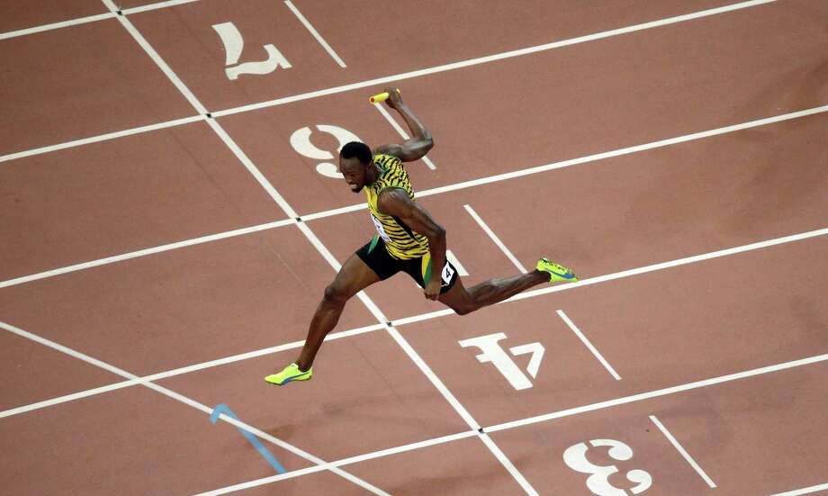 Jamaica's Usain Bolt crosses the finish line as Jamaica wins the men's 4x100m relay final at the World Athletics Championships at the Bird's Nest stadium in Beijing, Saturday, Aug. 29, 2015. (AP Photo/Wong Maye-E)  ORG XMIT: WTC443 Photo: Wong Maye-E / AP