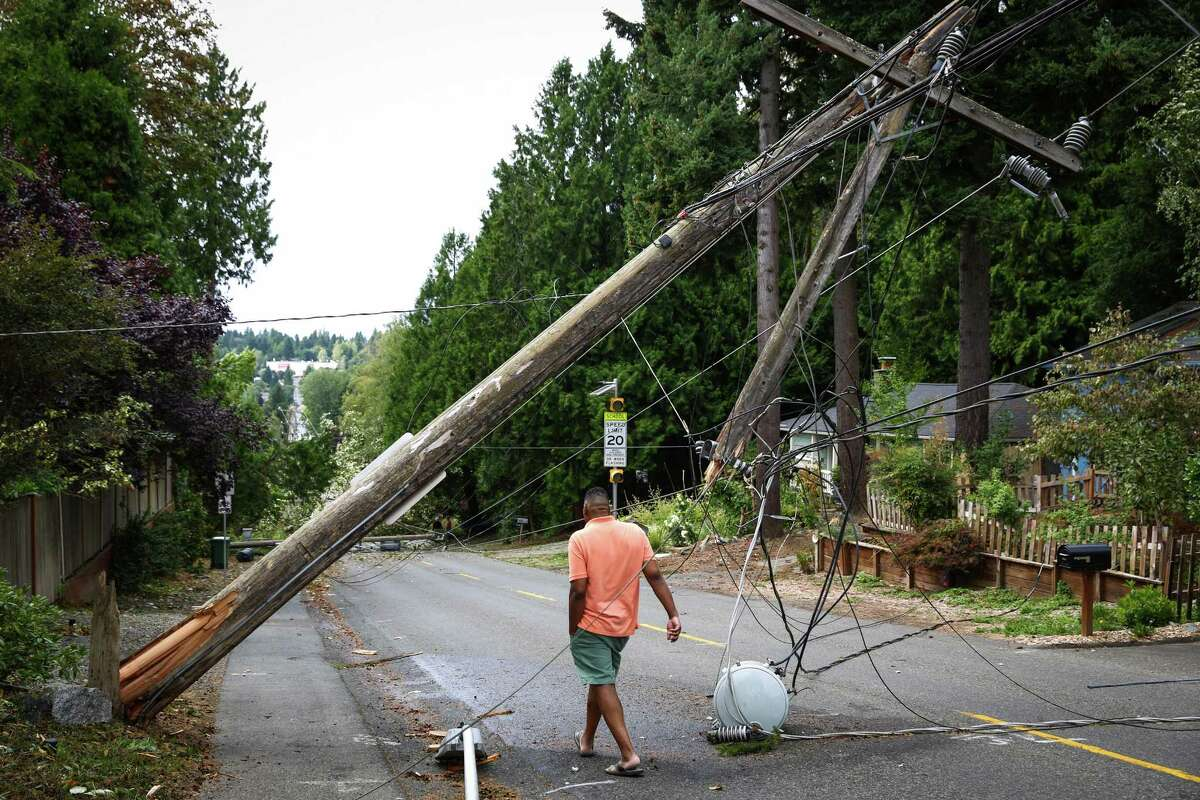 A block-long length of power lines and poles are shown in Lake City after they were knocked down during a windstorm that caused damage across the Pacific Northwest on Saturday, Aug. 29, 2015.