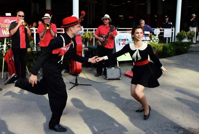 Nathan Bugh, left, and Gaby Cook swing dance to music by the band Reggie's Red Hot Feet Warmers at t