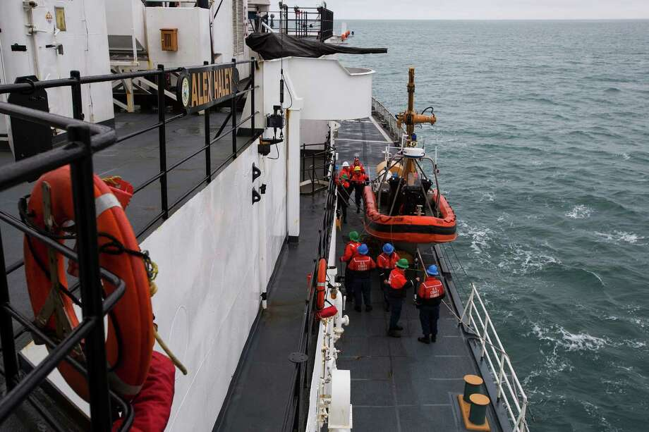 Crew members lower one of the small boats for exercises from the Coast Guard ship the Alex Haley on patrol in the Chukchi Sea off the coast of Alaska, Aug. 8, 2015. With warming seas creating new opportunities at the top of the world, nations are scrambling over the Arctic. But Russia may be beating the US to the punch. (Ruth Fremson/The New York Times) ORG XMIT: XNYT21 Photo: RUTH FREMSON / NYTNS