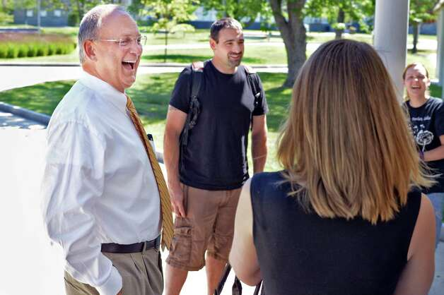 Hudson Valley Community College President Andrew J. Matonak shares a laugh with students on campus Friday July 31, 2015 in Troy, NY.  (John Carl D'Annibale / Times Union) Photo: John Carl D'Annibale / 10032827A