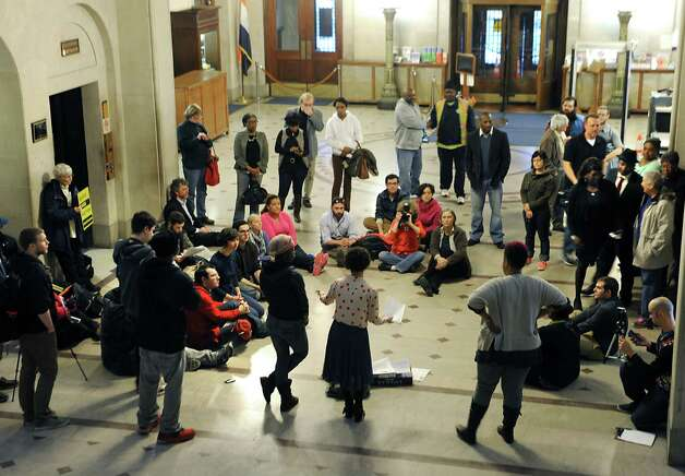 People participate in a teach-in to learn about how to form a cop watch in the lobby of the Albany City Hall on Monday, April 6, 2015 in Albany, N.Y. The people then walked upstairs to voice their opinion over Donald Ivy's death last week after a police encounter with a Taser in the Common Council chamber. (Lori Van Buren / Times Union) Photo: Lori Van Buren / 00031326A