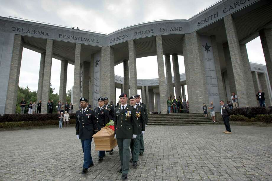 Soldiers of the U.S. and Belgian Army carry the coffin of Augusta Chiwy during a memorial service at the Mardasson Memorial in Bastogne, Belgium on Saturday, Aug. 29, 2015. Augusta Chiwy, 94, a Belgian nurse who helped save hundreds of American soldiers during the Battle of the Bulge at the end of World War II, was buried Saturday near where thousands of Allied troops fell. (AP Photo/Virginia Mayo) Photo: Virginia Mayo, STF / AP