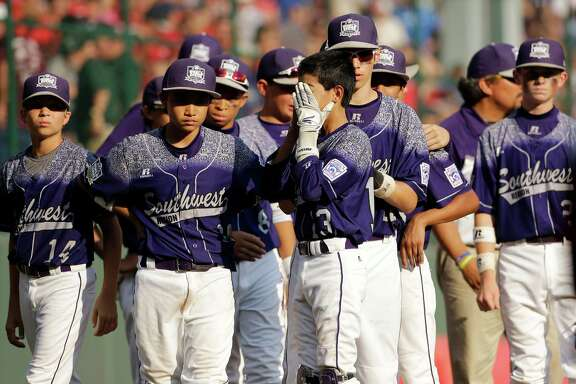 Pearland West players show their disappointment after Chayton Krauss of Lewisberry, Pa., stroked a walk-off single in the bottom of the sixth inning to deny Pearland the U.S. title on Saturday in South Williamsport, Pa.