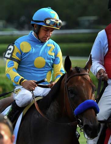 Victor Espinoza sits dejected atop American Pharoah after placing second in the 146th running of the Travers Stakes Saturday evening Aug. 29, 2015 at the Saratoga Race Course in Saratoga Springs, N.Y.    (Skip Dickstein/Times Union) Photo: SKIP DICKSTEIN / 00033110A