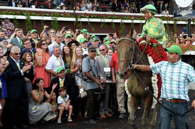 #7 Keen Ice with jockey Javier Castellano, is circulated in the winner's circle after winning the 146th running of the Travers Stakes Saturday evening Aug. 29, 2015 at the Saratoga Race Course in Saratoga Springs, N.Y.    (Skip Dickstein/Times Union) Photo: SKIP DICKSTEIN / 00033110A