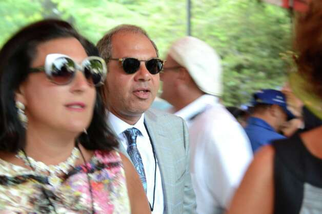 American Pharoah owner Ahmed Zayat leaves the paddock for the start of the Travers Stakes at Saratoga Race Course Saturday afternoon, Aug. 29, 2015, in Saratoga Springs, N.Y. (Will Waldron/Times Union) Photo: WW / 00033155B