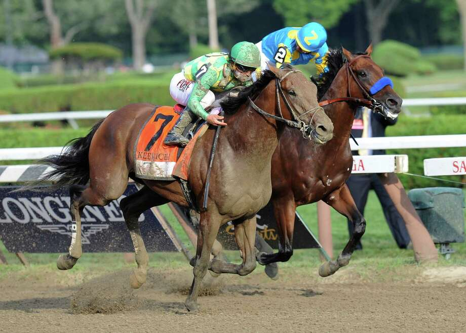 Keen Ice (7), with Javier Castellano, moves past Triple Crown winner American Pharoah, with Victor Espinoza, to win the Travers Stakes on Saturday at Saratoga Race Course in Saratoga Springs, N.Y. Photo: Hans Pennink, FRE / FR58980 AP