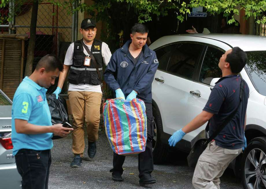 Thai policemen take evidence at an apartment on the outskirts of Bangkok, Thailand on Saturday, Aug. 29, 2015. Thai authorities raided an apartment in suburban Bangkok and arrested a foreigner with a fake Turkish passport and bomb-making materials Saturday, the first possible breakthrough in the deadly bombing at a Bangkok shrine nearly two weeks ago.(AP Photo/Sakchi Lalit) Photo: Sakchai Lalit, STF / AP