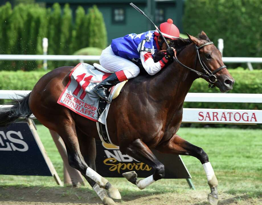 Run Happy with jockey Edgar Prado wins the 31st running of The King's Bishop Saturday afternoon Aug. 29, 2015 at the Saratoga Race Course in Saratoga Springs, N.Y.    (Skip Dickstein/Times Union) Photo: SKIP DICKSTEIN / 00033110A