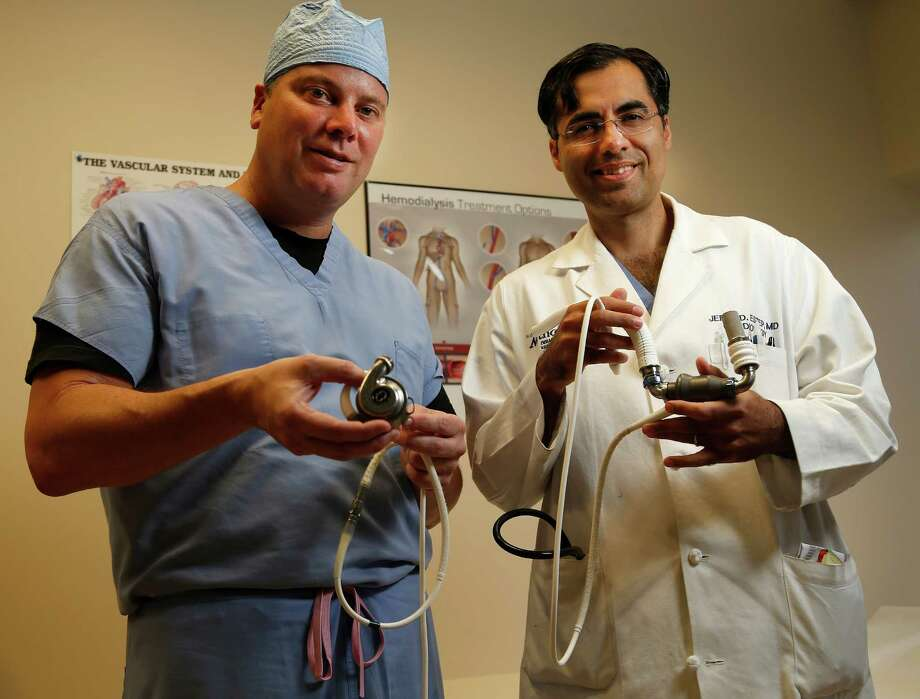"Dr. Brian Bruckner, left, a heart transplant surgeon, and Dr. Jerry Estep, cardiologist, display two versions of the left ventricular assist devices at Houston Methodist Hospital. ""These patients have meaningful improvements in quality of life,"" Estep says. Photo: Karen Warren, Staff / © 2015 Houston Chronicle"