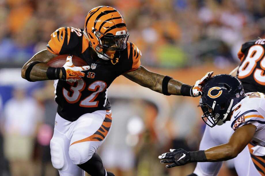 Cincinnati Bengals running back Jeremy Hill (32) fends off Chicago Bears free safety Brock Vereen (45) on a touchdown run in the first half of an NFL preseason football game, Saturday, Aug. 29, 2015, in Cincinnati. (AP Photo/Michael Conroy) Photo: Michael Conroy, STF / AP