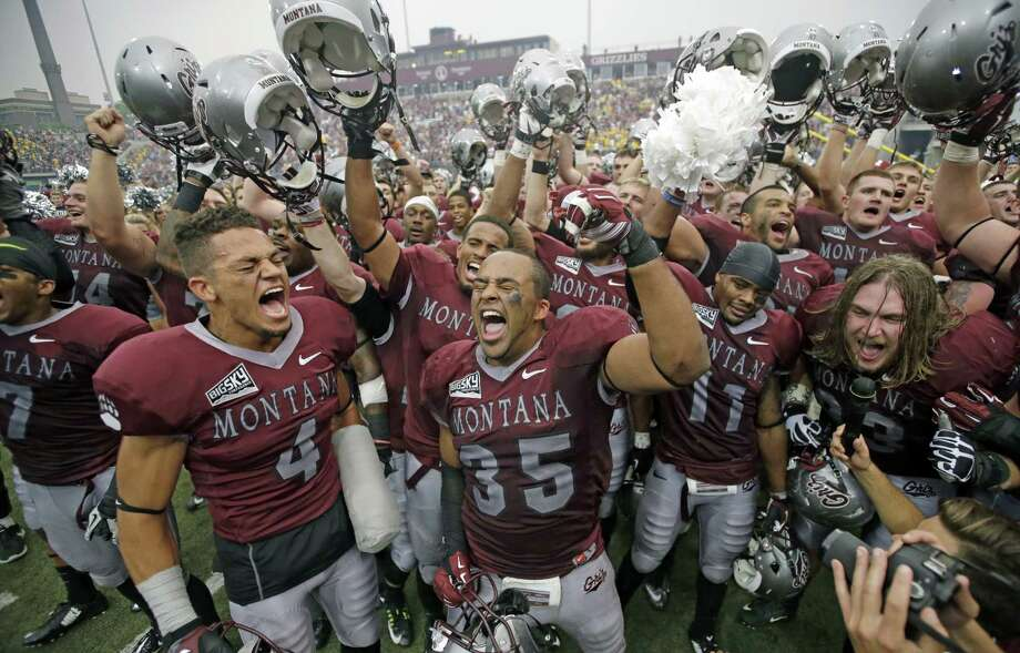Montana's Chris Parker (4) and Kendrick Van Ackeren (35) celebrate with teammates after the upset win over FCS champion North Dakota State. Photo: Rick Bowmer, STF / AP