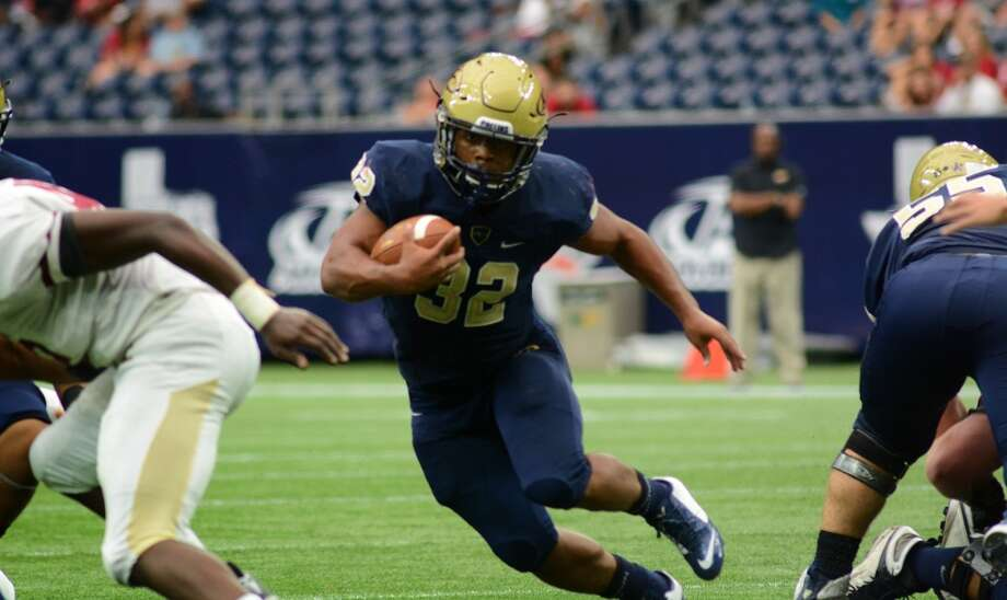 Aug. 29: Klein Collins 62, Cypress Woods 21Klein Collins senior running back Justin Pratt (32) works for yardage against the Cy Woods defense in the 2nd quarter of their matchup as part of a high school football doubleheader at NRG Stadium in Houston on Saturday, August 29, 2015. (Photo by Jerry Baker/Freelance) Photo: For The Houston Chronicle