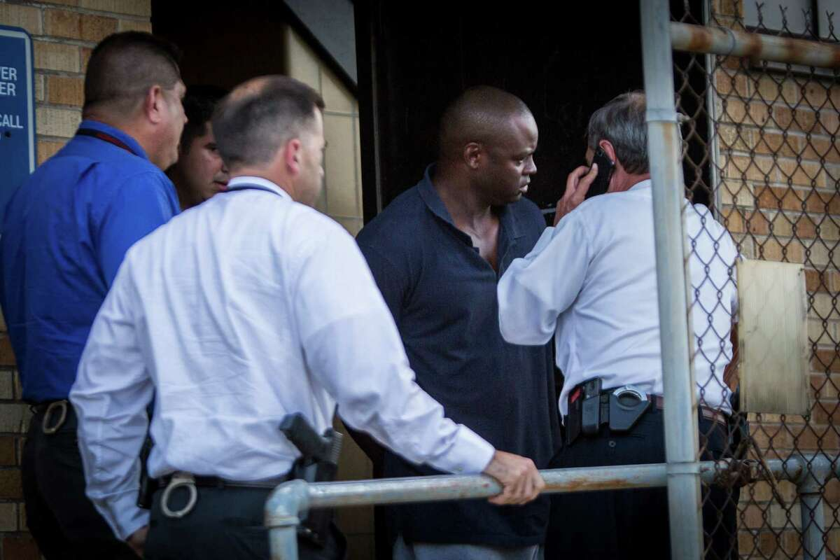 Shannon Miles, 30, charged with capital murder, is walked out of the Harris County Sheriff's Department after his arrest.