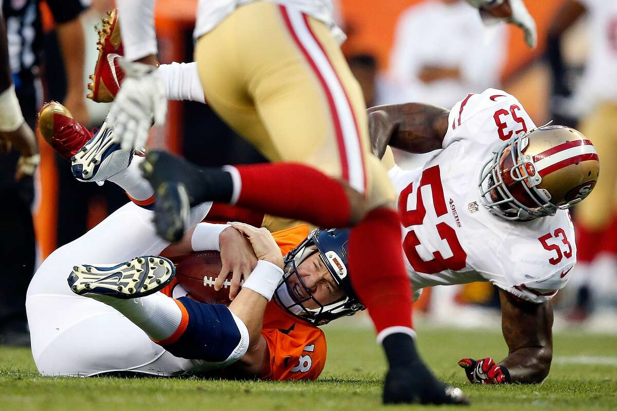 DENVER, CO - AUGUST 29: Quarterback Peyton Manning #18 of the Denver Broncos is sacked by inside linebacker NaVorro Bowman #53 of the San Francisco 49ers during preseason action at Sports Authority Field at Mile High on August 29, 2015 in Denver, Colorado. (Photo by Doug Pensinger/Getty Images)