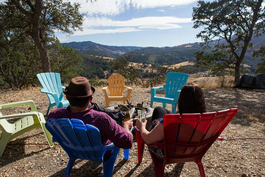 Joshua and Shelley Engberg relax at a view spot just outside their tiny home in the East Bay hills. Photo: Nathaniel Y. Downes, The Chronicle