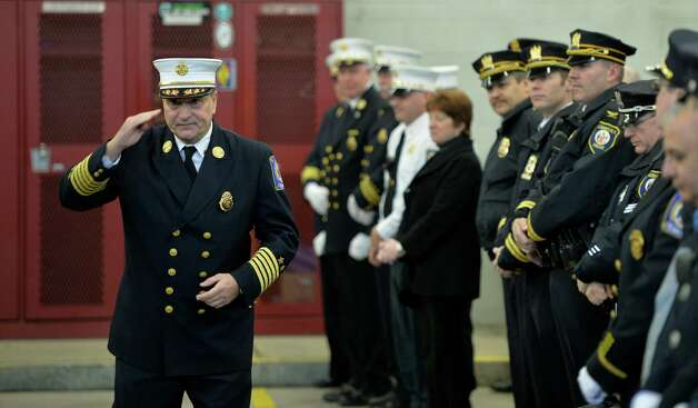 Chief Robert Forezzi salutes to the crowd during his retirement ceremony Monday, Dec. 30, 2013, at the South End Firehouse in Albany, N.Y. He died Saturday, Aug. 29, 2015. Chief Forezzi has been with the department for nearly 40 years. (Skip Dickstein / Times Union archive) Photo: SKIP DICKSTEIN / 0025165A