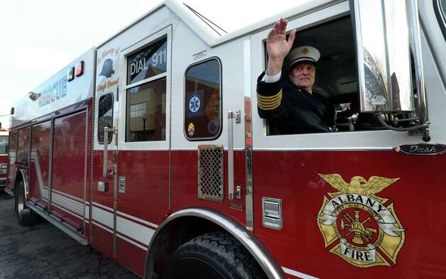 Chief Robert Forezzi waves from the front seat of the Rescue Squad as he leaves the firehouse during his retirement ceremony Monday, Dec. 30, 2013, at the South End Firehouse in Albany, N.Y. Chief Forezzi has been with the department for nearly 40 years. He died Saturday, Aug. 29, 2015. (Skip Dickstein / Times Union archive) Photo: SKIP DICKSTEIN / 0025165A