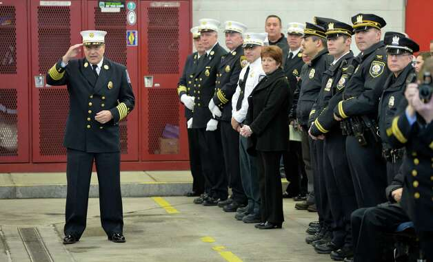 Chief Robert Forezzi salutes Mayor Jerry Jennings during his retirement ceremony Monday, Dec. 30, 2013, at the South End Firehouse in Albany, N.Y. Chief Forezzi has been with the department for nearly 40 years. He died Saturday, Aug. 29, 2015.  (Skip Dickstein / Times Union archive) Photo: SKIP DICKSTEIN / 0025165A