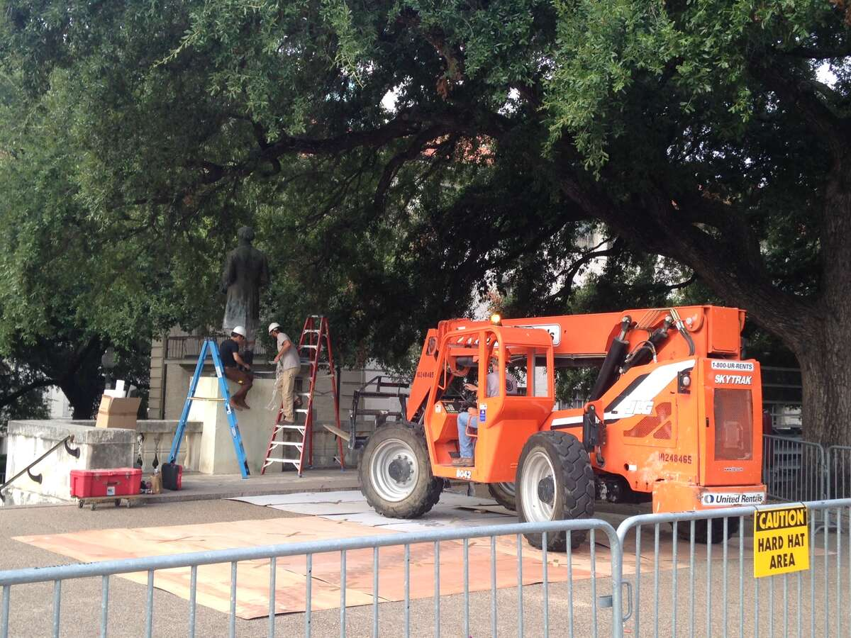 A lift is put into place before the removal of the University of Texas at Austin's Jefferson Davis statue on Sunday, August 30, 2015.